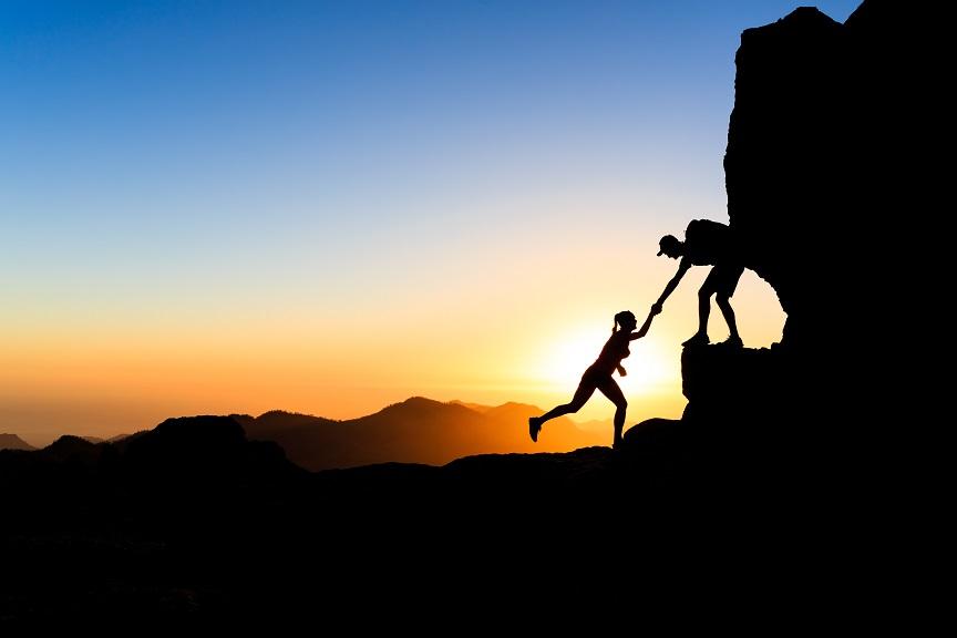 teamwork-couple-climbing-helping-hand-PXTWEP4.jpg